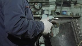 Close-up Blacksmith With A Welding Machine Fastens Parts
