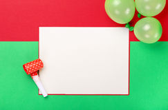 Close up blank card with holiday items on colorful background Royalty Free Stock Photography