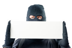 Close-up blank for inscriptions and a portrait of a criminal in. A balaclava on a white background Royalty Free Stock Images