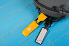 Close up of blank luggage tag label on suitcase or bag with travel insurance. Royalty Free Stock Photography