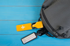 Close up of blank luggage tag label on suitcase or bag with travel insurance. Travel insurance label tied to a backpack Stock Images