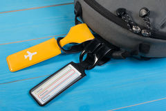 Close up of blank luggage tag label on suitcase or bag with travel insurance. Travel insurance label tied to a backpack Royalty Free Stock Photography
