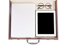 Close up blank tablet, laptop and glasses in briefcase Royalty Free Stock Images