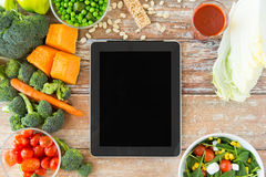 Close up of blank tablet pc screen and vegetables Stock Images