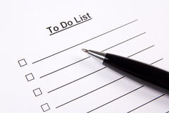 Close up of blank to do list and pen Royalty Free Stock Images