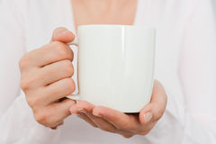 Close-up of Blank white cup in woman hand Royalty Free Stock Image