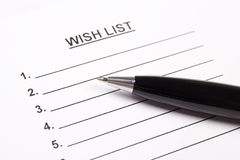Close up of blank wish list and pen Stock Photography