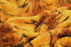 Close up of blanket in tiger pattern texture background.  stock image