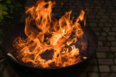 Blazing Fire in Grill. Close-up of blazing fire in rustic BBQ grill at evening stock photos