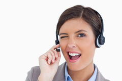 Close up of blinking call center agent. Against a white background royalty free stock images