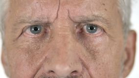 Close Up of Blinking Eyes of Old Man stock video footage