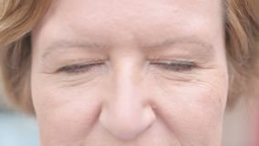 Close up of Blinking Eyes of Old Woman. The Close up of Blinking Eyes of Old Woman stock footage