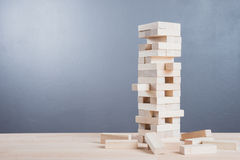 Close up blocks wood game on wooden table background. Royalty Free Stock Images