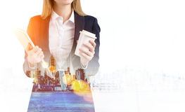 Close up of blond businesswoman with coffee and notebook in mist Royalty Free Stock Image