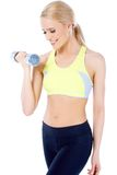 Close up of blond happy woman with dumbbell Royalty Free Stock Photos