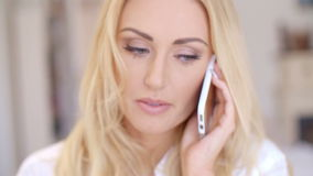Close up Blond Woman Calling Through Phone. Close up Attractive Young Blond Woman Calling Someone Through her Mobile Phone stock video