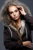 Close up of blond woman wearing hooded sweatshirt Royalty Free Stock Image