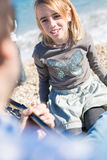 Close-up of blonde girl singing song on beach Royalty Free Stock Images