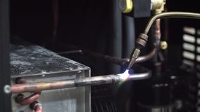 Close-up on blow torch fusing copper tube together with solder. Clip. Close-up shot of a man welding a pipe stock video footage