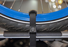 The close up of blue bicycle wheel on the car roof. Royalty Free Stock Photography
