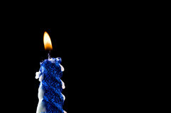 Close-up blue candle isolated on black Royalty Free Stock Images