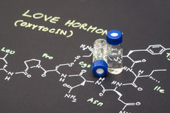 Close-up blue cap sample vial on paper with chemical formula of Royalty Free Stock Photography