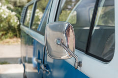 Close up of a blue car and rear view mirror. Close up of a vintage blue car and rear view mirror royalty free stock photo