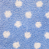 Close Up of Blue Carpet with White Polka Dots Stock Photo