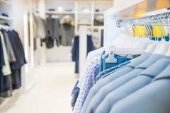 Close up Blue color Clothes on hangers in shop, butique. Make Outfit set. Shopping Mall. Shopper. Sales. Shopping Center. Selectiv. E focus, space for text Stock Photos