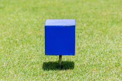 Close-up blue color wooden tee off area or tee box with blurred Royalty Free Stock Photo