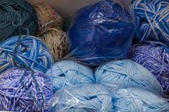 Close up of blue coloured balls of wool and yarn. Close up of various shades of blue balls of wool and yarn for knitting projects and home crafting stock photography