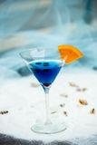 Close up of blue cool refreshing summer cocktail drink with blue Stock Images