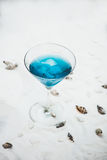 Close up of blue cool refreshing summer cocktail drink with ice Royalty Free Stock Images