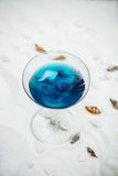 Close up of blue cool refreshing summer cocktail drink with ice Royalty Free Stock Photography