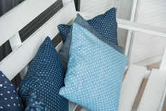Close-up of blue cushions lie on a wooden Stock Photography