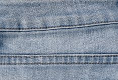 Close Up Blue Denim Jean Texture with Seams Royalty Free Stock Images