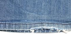 Blue denim jeans torn leg close up Royalty Free Stock Photo