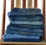 Close up of blue denim jeans. On wooden stock image