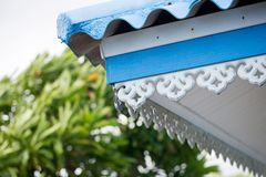 Close up blue eaves thai style. Asian achitecture. eaves roof thai style. image for background. And copy space stock image