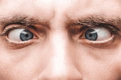 Close-up of the blue eye of a frightened man Royalty Free Stock Photos