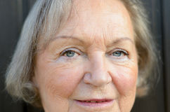 Close up of the blue eyes of an elderly lady Stock Image