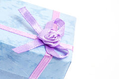 Close up of blue gift box with purple ribbon Royalty Free Stock Images