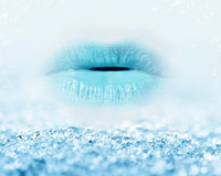 Close-up of blue girl lips with mist and icy snow. Beauty and winter concept Stock Image