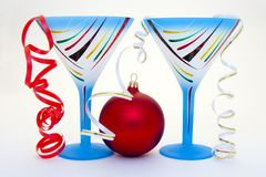 Close up of a blue glass and new years ball. Close up of a blue glass and new years red ball Royalty Free Stock Image