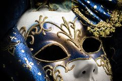 Close up of a blue with gold elegant traditional venetian mask over white background royalty free stock photography
