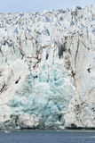 Close up of blue ice in the glacier by the sea, Svalbard Stock Images