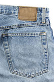 Close-up blue jean. With pocket and blank leather label  on white background Stock Photos