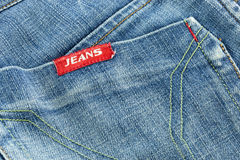 Close-up blue jean. With pocket and blank leather label  on white background Royalty Free Stock Photo