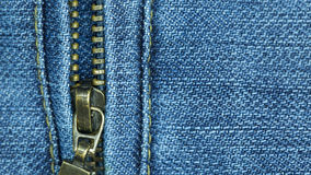 Close-up blue jean and zipper for texture and background. Stock Photo