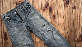 Close up of blue jeans ,Blue Jeans texture on wooden floor. Blue Jeans texture on wooden floor Stock Photos
